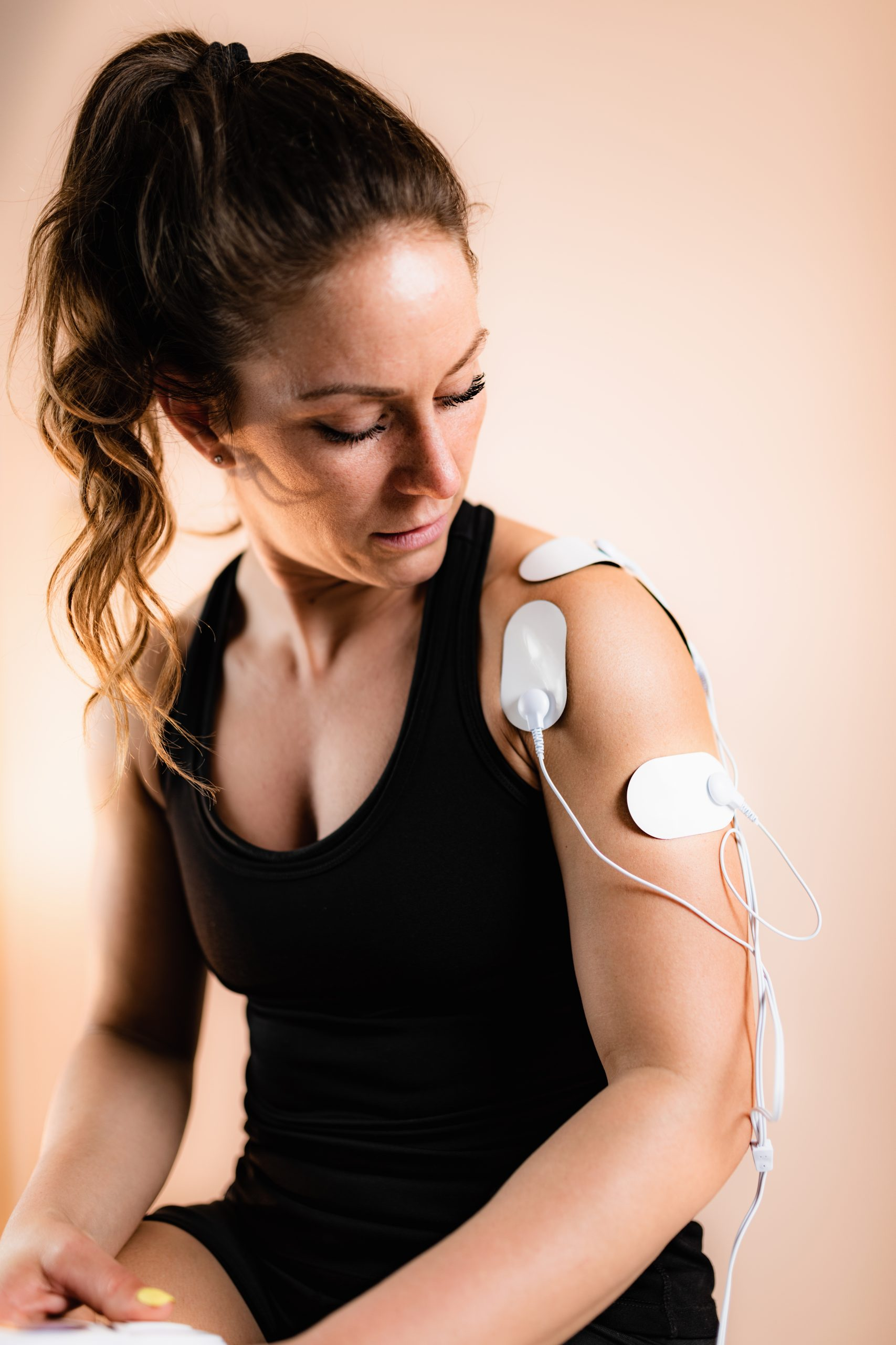 Shoulder Physical Therapy with TENS Electrode Pads, Transcutaneous Electrical Nerve Stimulation.